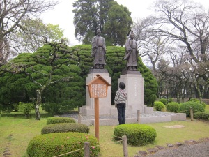 Monument to the two daimyos who built the garden. The woman bowed deeply to each one and stood there for a long time.