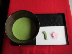 Frothy, powdered green tea with sweets. Note the pink sakura